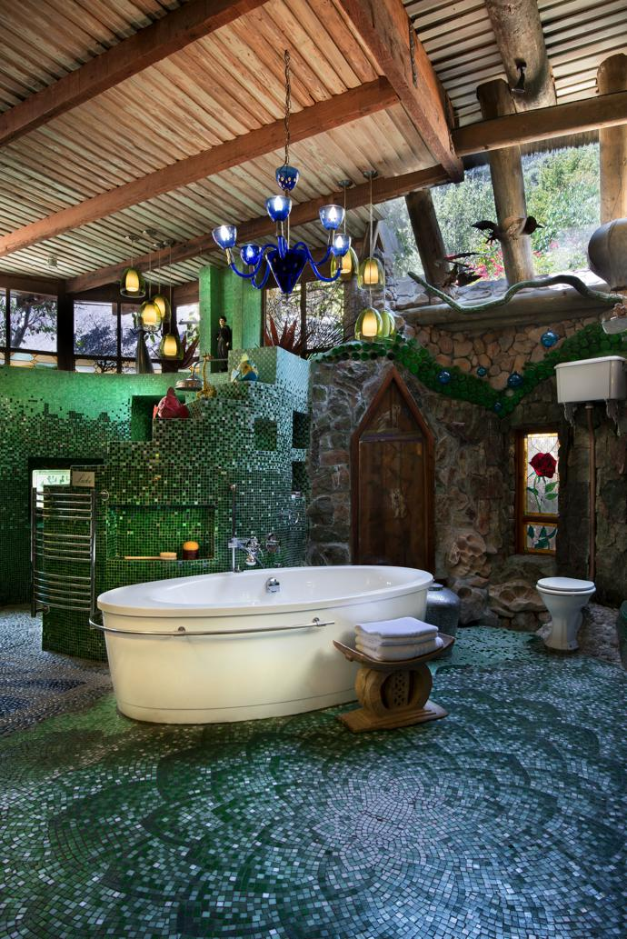 Mosaics in classic shades of green in one of the spacious, light filled bathrooms create the feel of a traditional hammam. The artworks are from Mark Valentine's Amatuli, and the pendant lights were bought on travels to fairs in Italy and France.