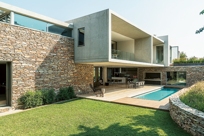 """On the northern side, we used an L-shaped groundfloor plan to tuck the house into the koppie and create a contained space where the connection to the hill feels tangible,"" says architect Luke Chandler."