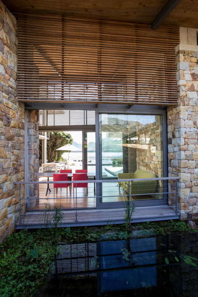 Every window in the house frames a picture-perfect scene. Slatted timber screening, shutters and decks are by Herbert Robinson; and the structural steelwork, handrailing and stairs are by Schrade Concepts. The sofa and chairs are from Scotch & Sofa.
