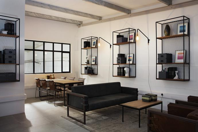 The wall units, sofas and armchairs in the winemaker's office are by Dark Horse, the table is by Conrad van der Westhuizen and the coffee table is by Pedersen + Lennard.