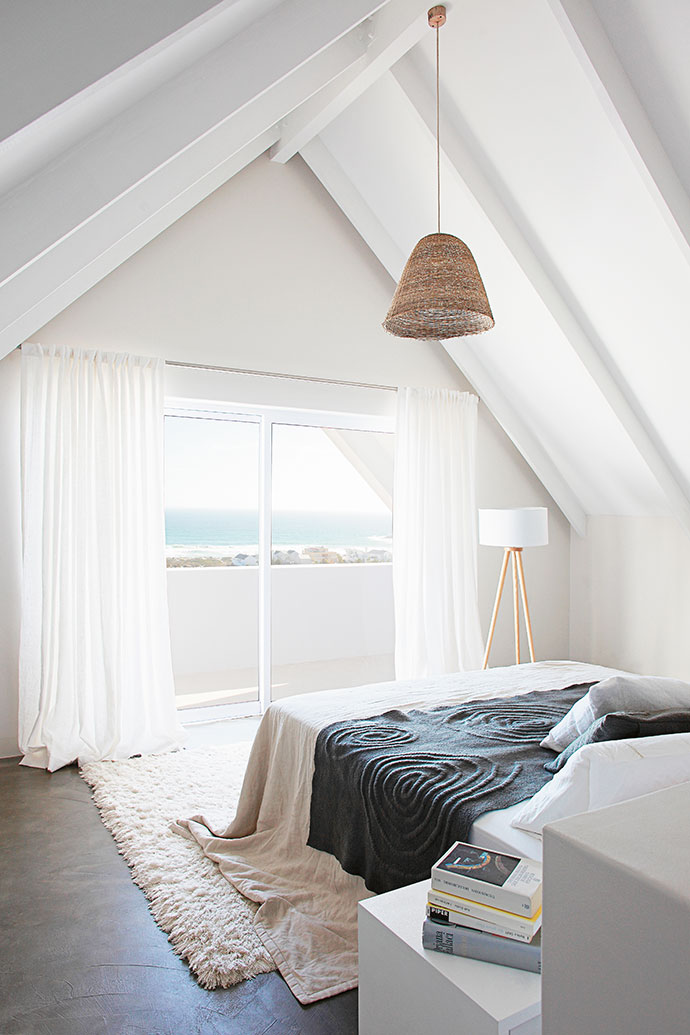 The tranquil upstairs bedroom has sea views.