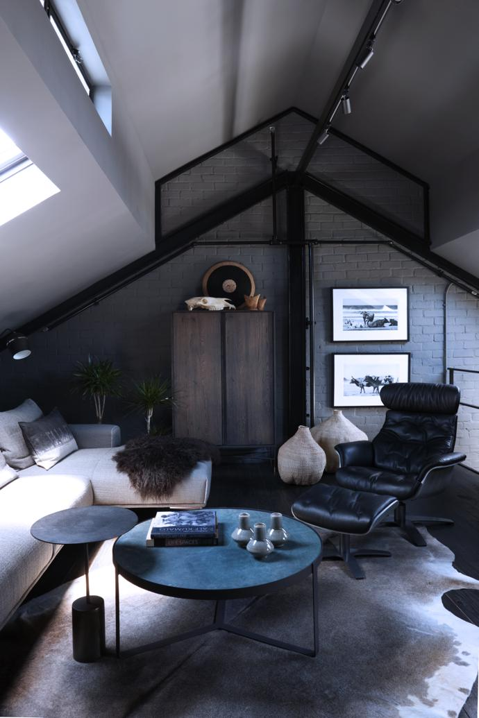On the mezzanine level above the bedroom, light pours in from a skylight onto a Maxa daybed. It's another texture festival as the leather top of the Austin coffee table, the Graphite aluminium-and iron occasional table, Bulawayo garlic gourd baskets and grey cowhide contrast with the Iconic recliner and ottoman and the wooden floor.
