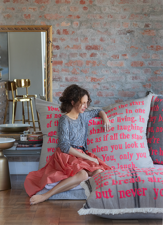 Karien Belle contemplates words and the world on her signature oversized pillows embroidered with poetry.