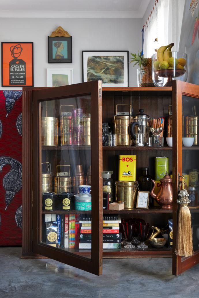 The antique cabinet was the first piece of furniture bought for this apartment. It contains Karien's Indian brass tiffins, found in a market in Old Delhi, and a collection of her favourite Mariage Frères teas.