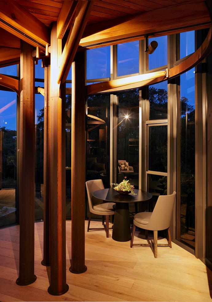 Steel rings, branch-like arms and Cor-Ten steel columns support all three levels of the house.