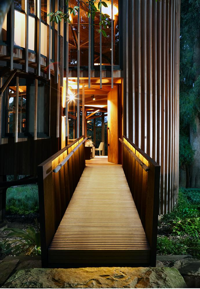 Wooden gangplank or magical portal? The unusual entrance to the Paarman cottage sets the mood for its innovative interior.