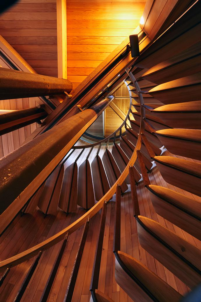 The organic nature of the house is carried through in the design of the staircase, with oak steps and a balustrade that was made by wetting strips of wood and letting them set in the curved shape.