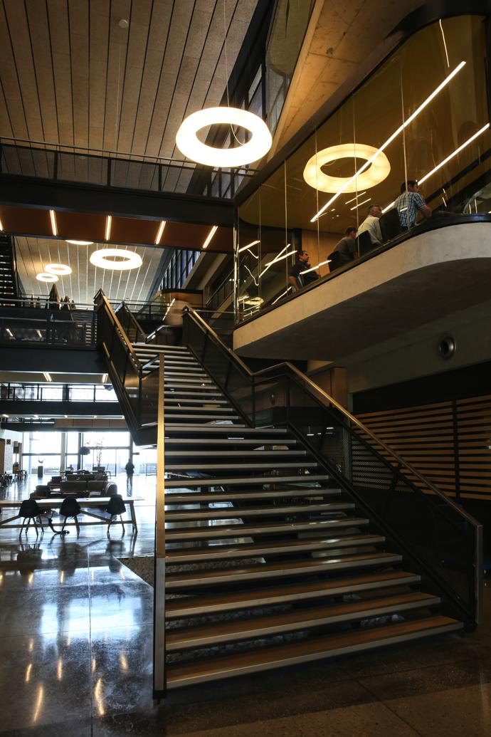 The cascading staircase that links all levels is off set in the atrium to reinforce its focal role.