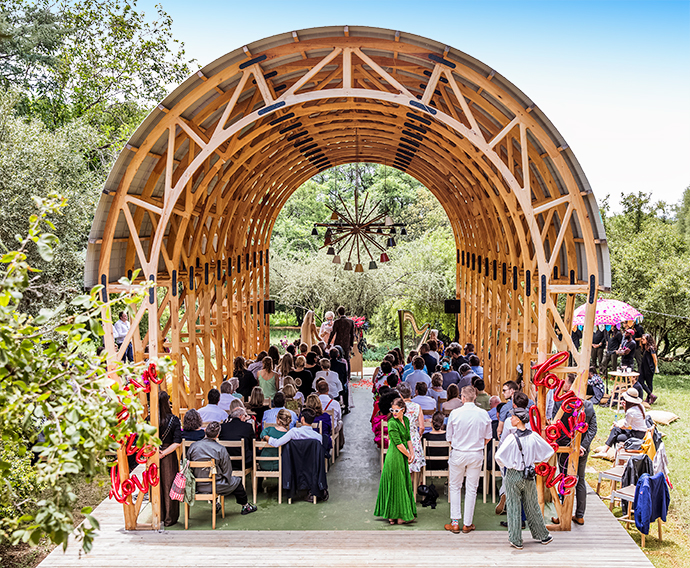 David Krynauw designed the modular chapel and the Haywire chandelier. Beautiful Indian umbrellas from Timeless Tents provided shade.