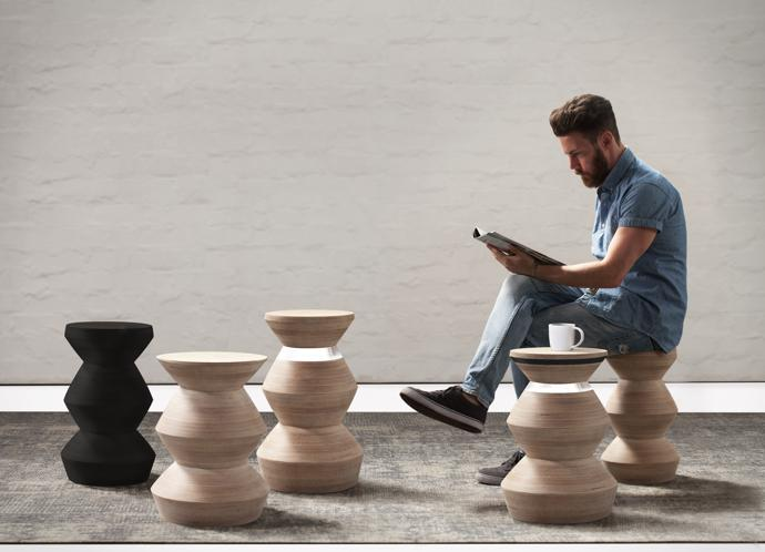 Duncan Stevens with a selection of pedestals/stools, which come in various forms, including solid wood in a natural finish.