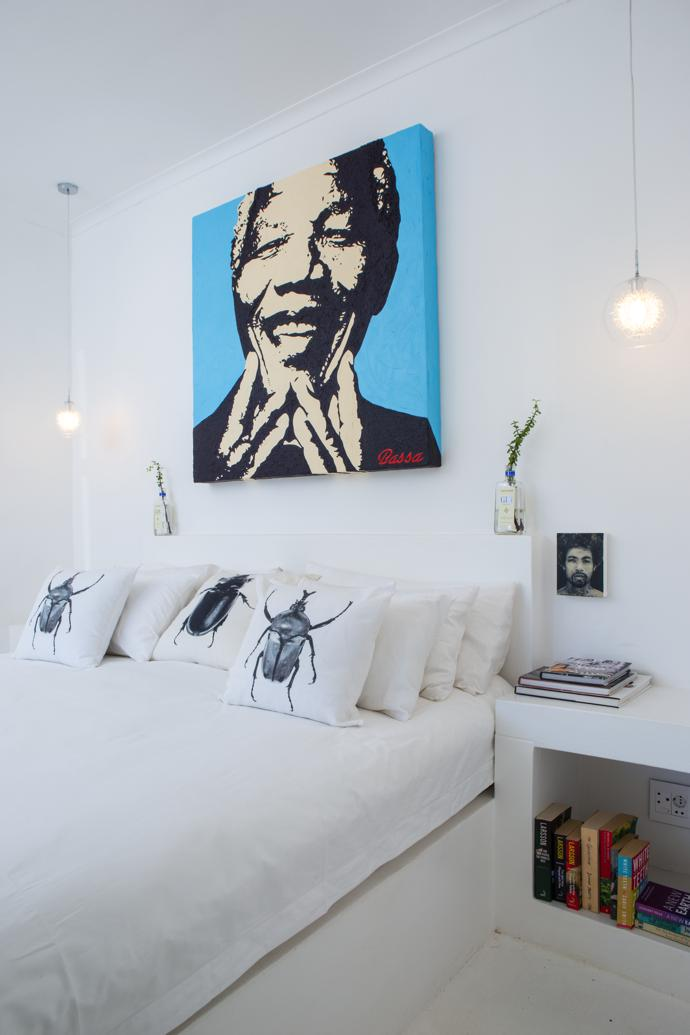 In the bedroom, Madiba Smile by Bassa Aspinall, scarab scatter cushions by Clinton Friedman and a portrait etching by JP Meyer. The concrete bed base, headboard and bedside tables are built-in.