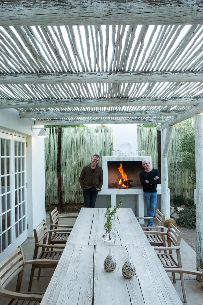Jonno and Johan enjoy time off in Prince Albert. Australian black-wattle latte screens provide gentle privacy in the succulent garden. The stoep ceiling is constructed using the same painted saplings and offers dappled shelter from the relentless Karoo summer sun.