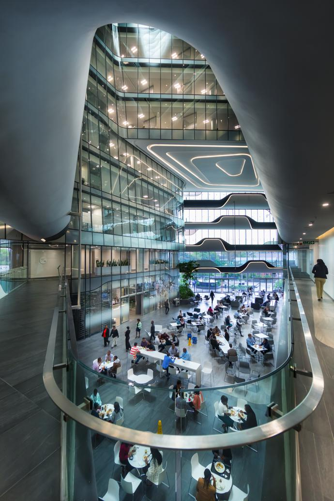 The spaceship-like south atrium with its glass, steel and organic curves. Here various dining options are available to staff and visitors.