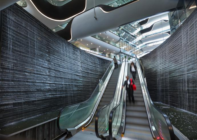 Ascending from the parking area, the escalators provide an entrance that increases the experience of the building as one approaches the ground level.