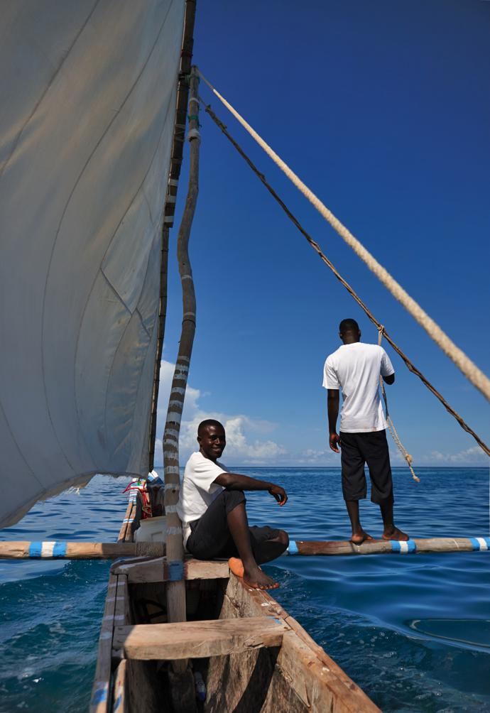 Juma and Haji Hamad on Aiyana's ngalawa, a traditional double outrigger canoe.