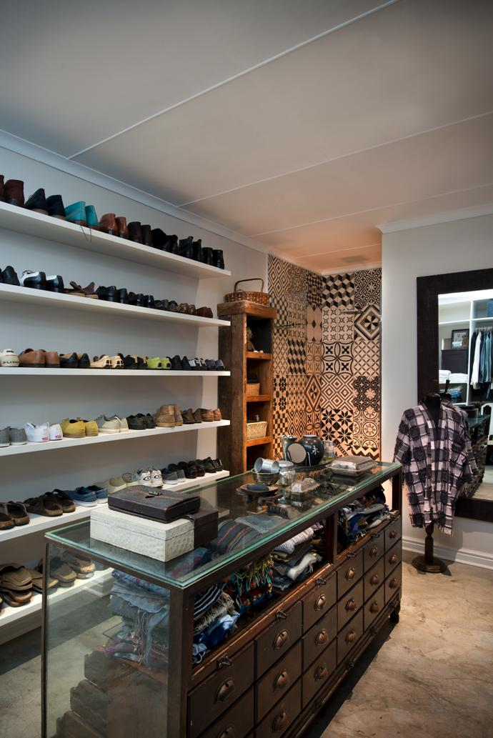 In the dressing room of the cottage, Moorish tiles line the shower, a vintage shop counter provides storage for scarves and smalls, and a lifetime's collection of shoes is ranged on floor-to-ceiling shelves.