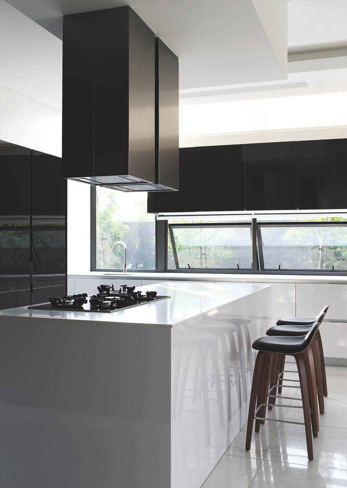 The functional design of the slick, monochromatic kitchen ensures only the necessary equipment is in sight.