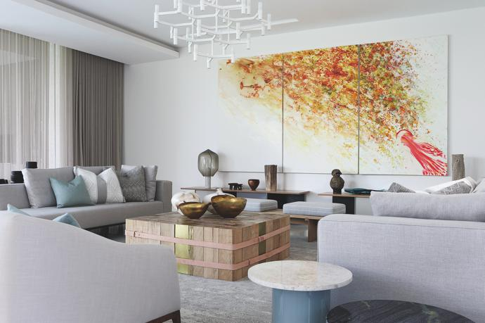 A triptych by South African artist Penny Siopis graces one of the walls in the formal lounge.