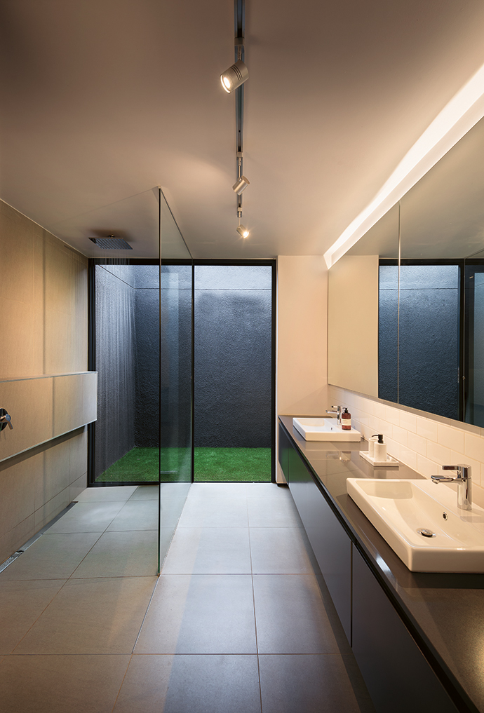 The main bathroom opens out on a north-facing light well that also functions as a private courtyard.