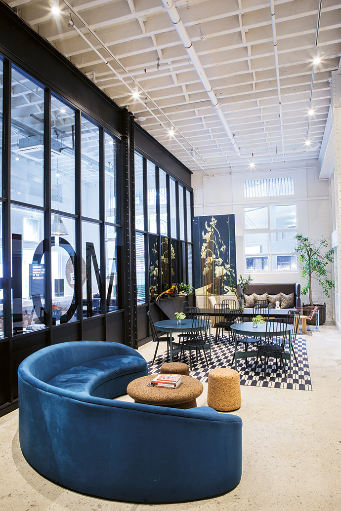 The lobby features furniture by Gregor Jenkin and Laurie Wiid van Heerden, and art by Sanell Aggenbach. The half-moon sofa and the love seat are by Liam Mooney.