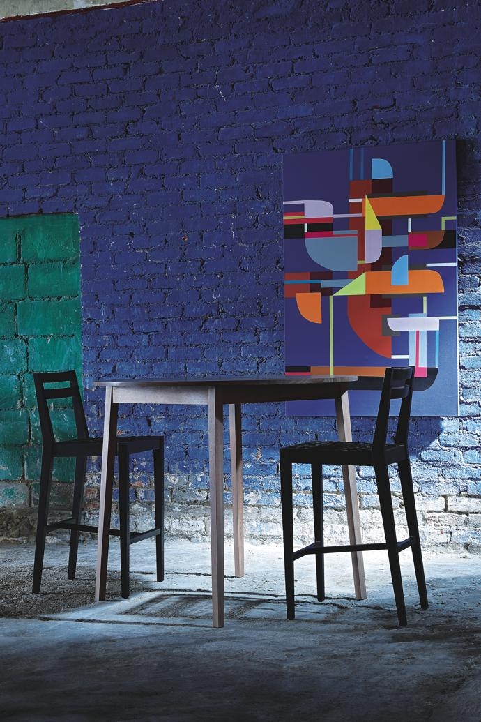 Tall table and tall chairs by James Mudge Furniture Studio, and painting from Spier Arts Trust by artist Henk Serfontein.
