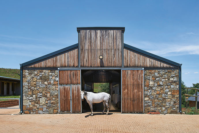 Like the house, the stables were built using a steel frame with infill stone and timber panels. The timber used is durable red river gum, which develops a beautiful silver patina with age.