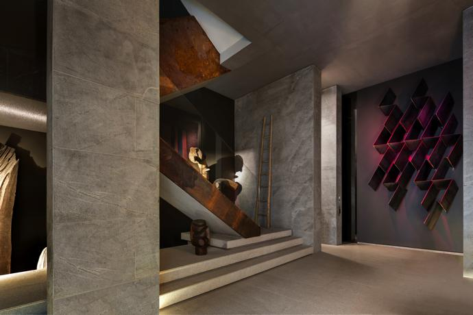 "According to SAOTA, the entrance façade responds to Le Corbusier's definition of architecture as a ""magnificent play of masses brought together in light"" – the journey through space and light that follows is clearly inspired by the Modernist movement. The steel wall sculpture is by Paul Edmunds."