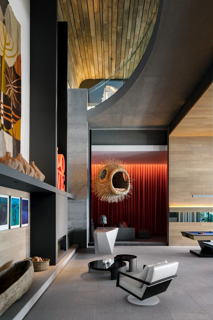 In cinema and games room the Blowfish by Porky Hefer is hanging in the double volume space. The STM chair and Barbuja coffee tables are by OKHA and are strategically placed next to the fire place. The Central African Makoro Dugout boat and African baskets sit below a Cecil Skotnes tapestry.