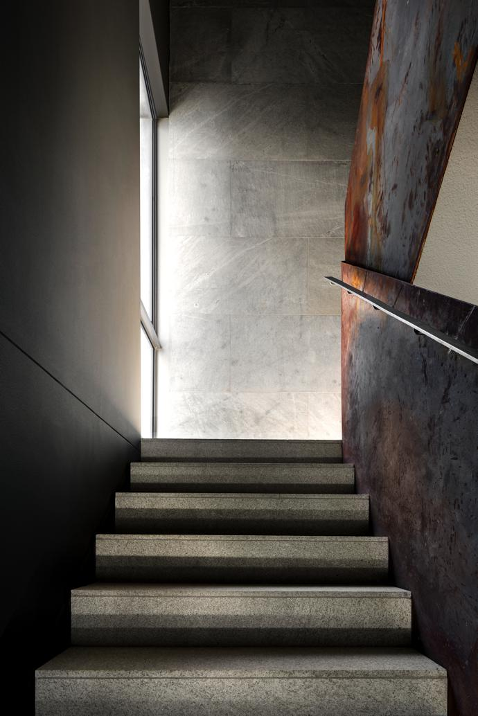 From the almost chiaroscuro treatment of the cavernous entrance hall the visitor is led upwards towards the generous light of the upper living levels.