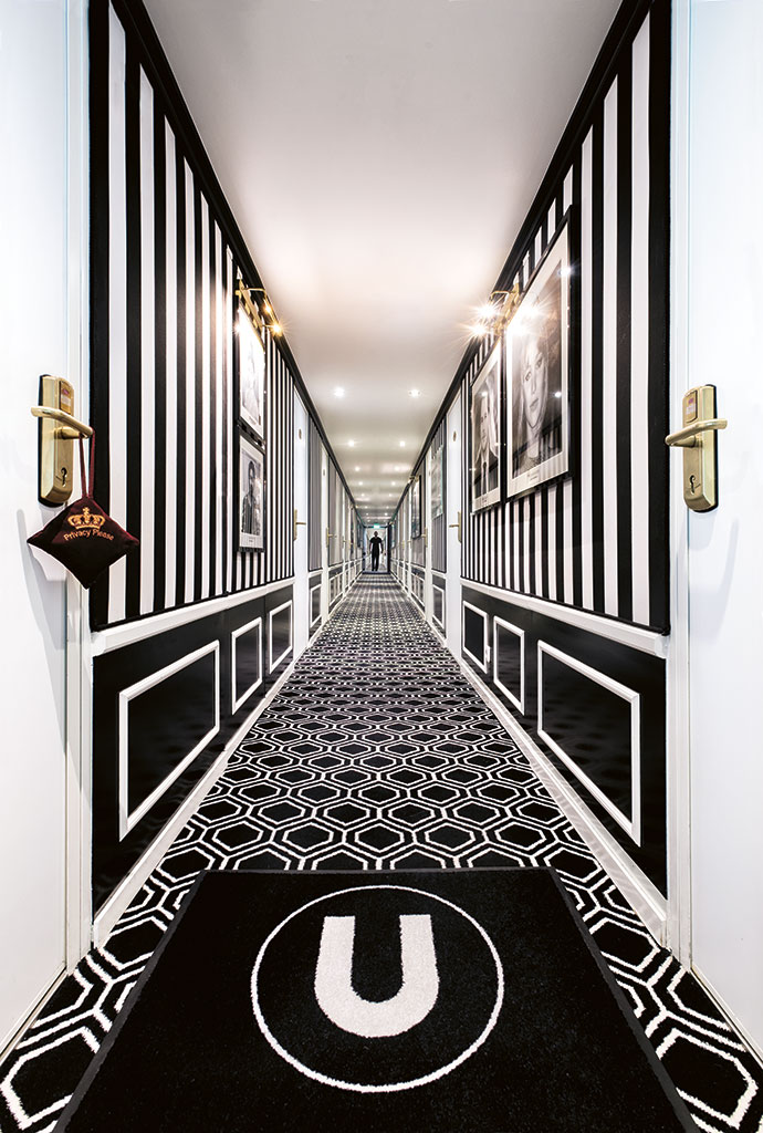 The slick, seemingly endless corridor to the cabins features black-and-white photographs of movie stars on the walls.