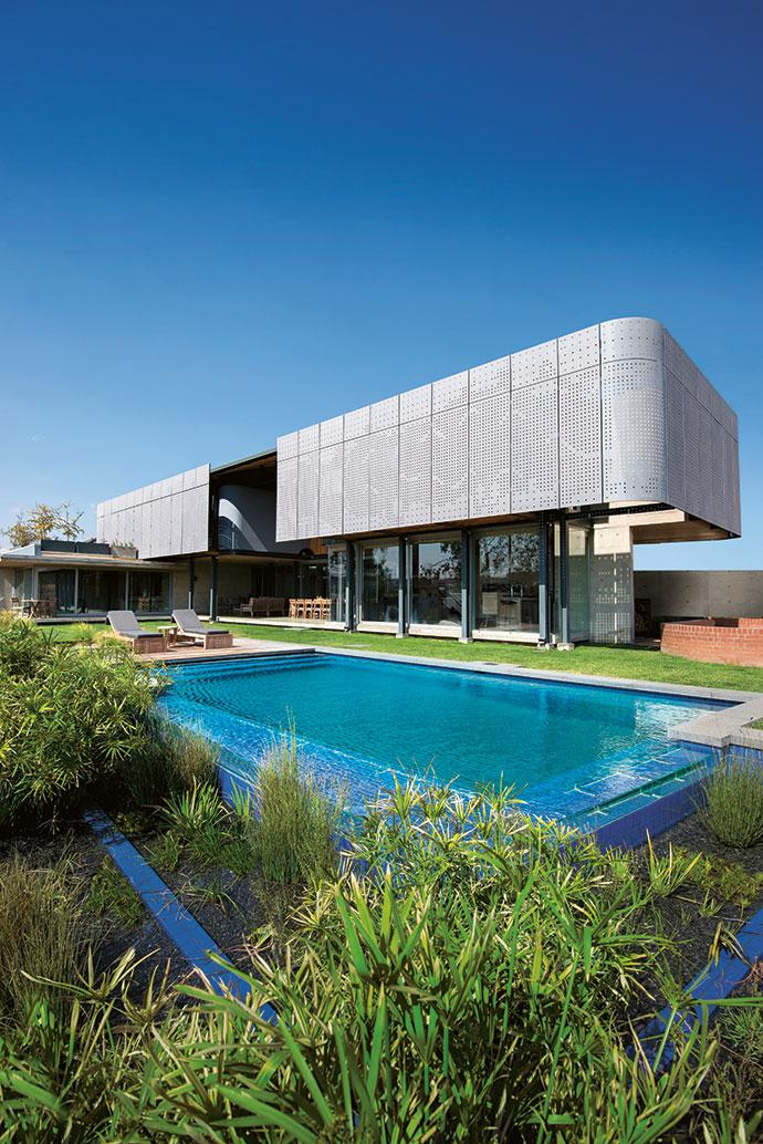 An eco-pool with a rim-flow edge blurs the boundary between the garden and the natural vegetation.