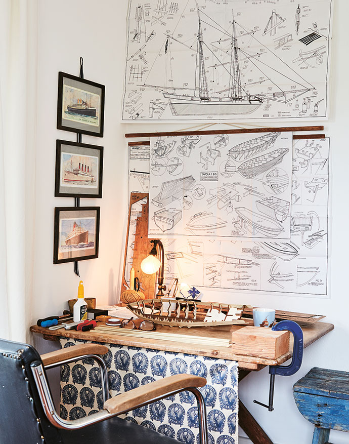 A Mediterranean nautical feel is evident in this bedroom, with a workspace in the corner where Jan-Georg builds elaborate models. At the moment he is busy with a ship, and the instructions, tacked up on the wall, are in Italian!
