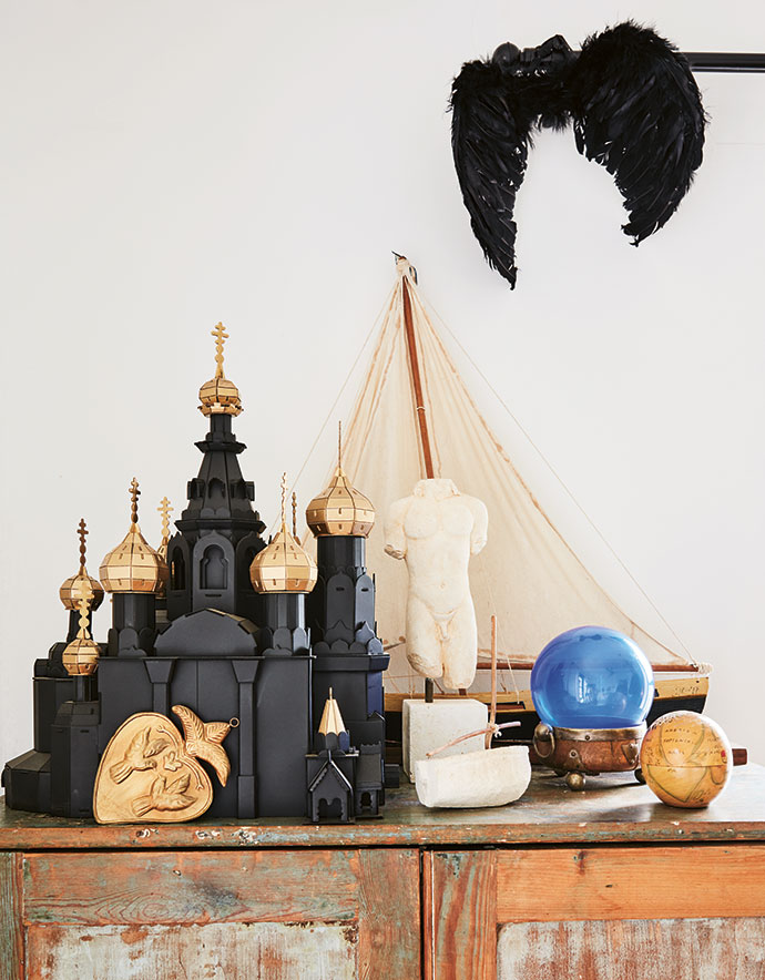 Mementos and models, including a black-and-gold St Basil's Cathedral.