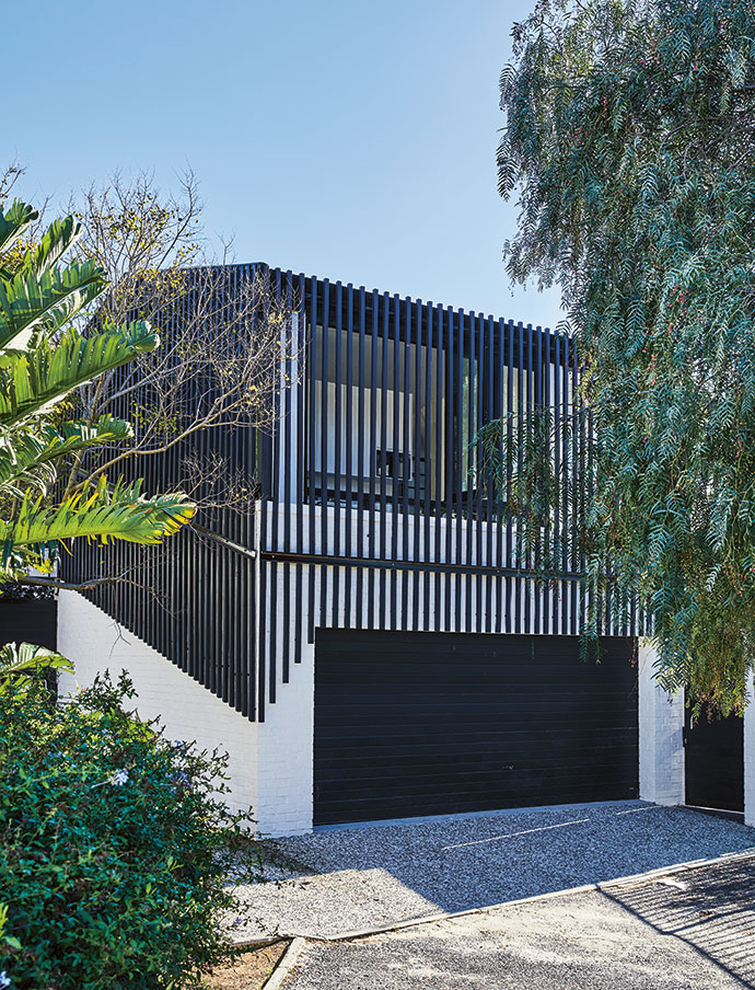 The charred-timber cladding was installed by Jacobs Flooring.