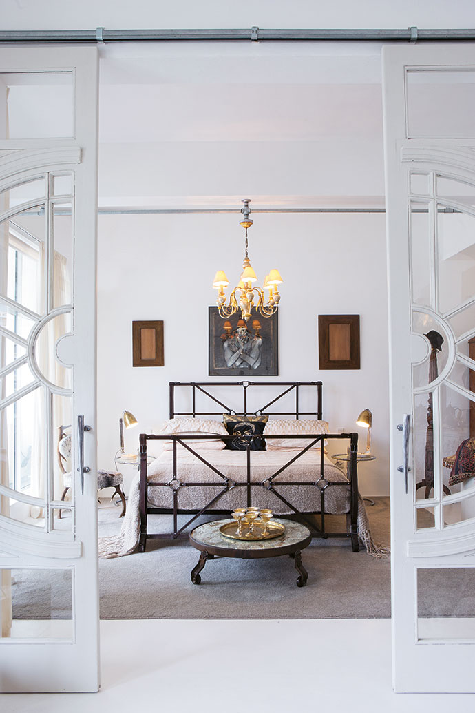 "The ""leather strappy style"" of the bed in the main bedroom appeals to Cecile, who thinks everything should be wearable fashion. The gold tray and wine goblets have sentimental value – the Pauls bought them in Krugersdorp, where they got married."