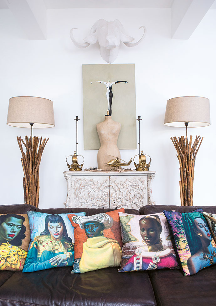 On top of the Baroque dresser stands an original 1920s Harrods dressmaking dummy and on either side of it two crowns, possibly of Indian origin, that were once shop props in Cecile's vintage shop, ThreadBARE, in Edinburgh. The painting is Brian's own work and the Tretchikoff cushions are from Baraka Gifts & Decor in Green Point.