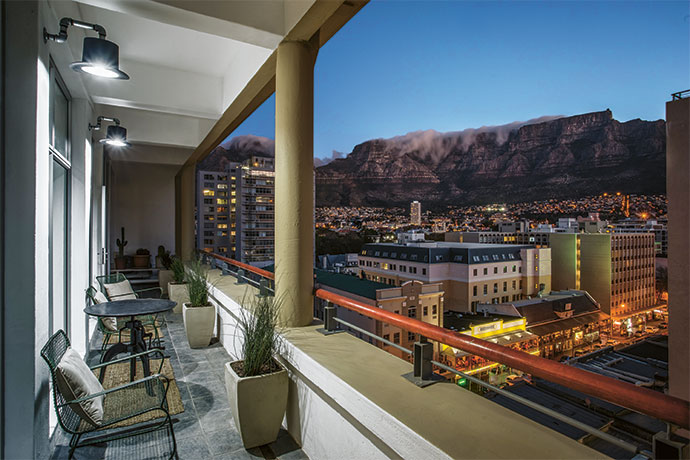 The incredible view of Table Mountain from the Pauls' enormous balcony. Brian used Champagne buckets to make the top-hat lights for the exterior of Cecile's vintage shop in Edinburgh.