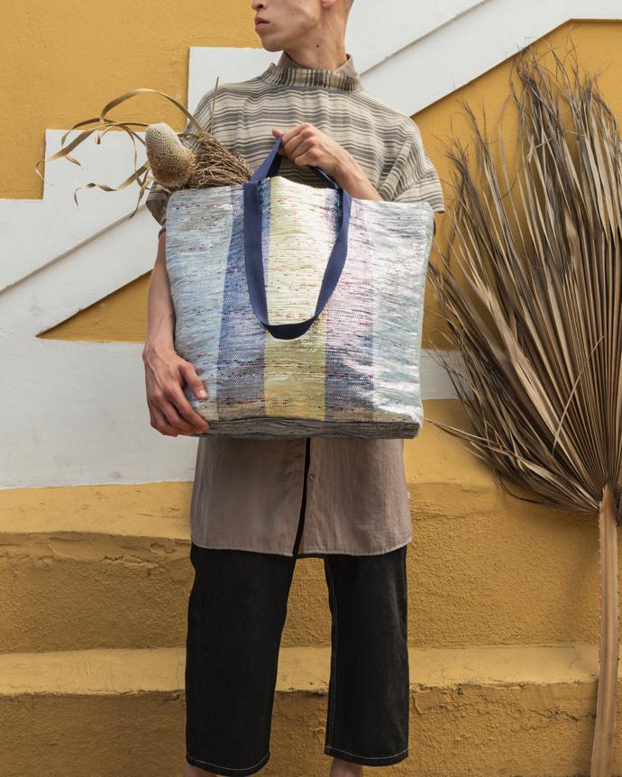 ÖVERALLT bag in polyester, polypropylene, polyethylene and aluminium. Designer Mariam Hazem and Hend Riad and Hanna Dalrot.