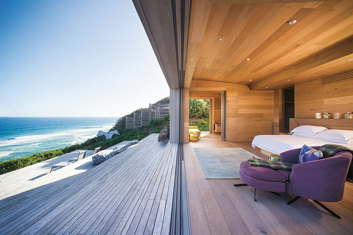 The main bedroom opens out to the terraced wooden deck – watched over by a whalebone angel – and uninterrupted sea views.