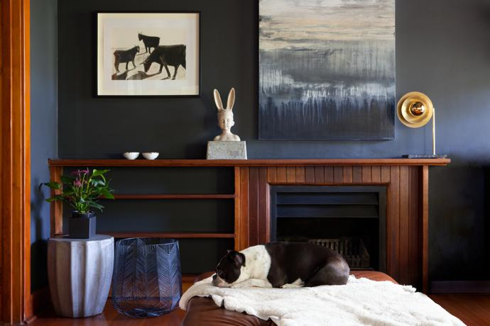 The artworks hanging above the fireplace are by Sam Nhlengethwa (left) and Melody French (right). The bunny on the mantlepiece is by Dina Louisa and the lamp by Coote and Wench.