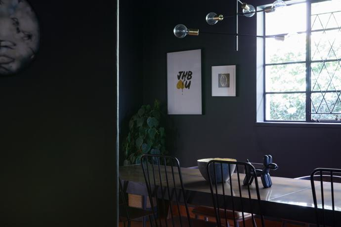 The artworks on the wall are by Jana+Koos (left) and Sandi Kuper (right). The goat on the table is by Hanneke Benade and the bowl on table is from the Zeitz MOCAA.