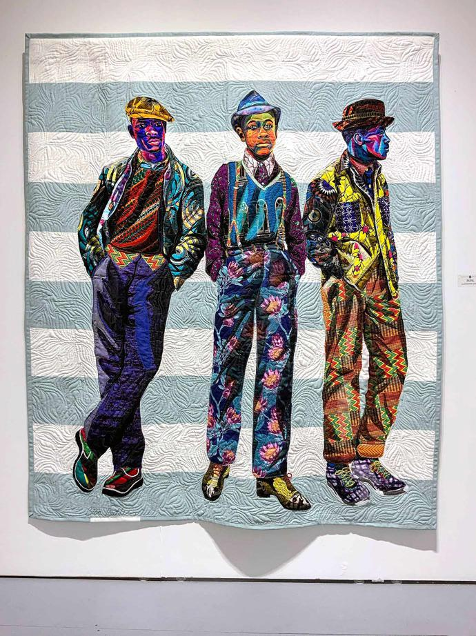 """The Mighty Gents"" (2018), quilted and appliquéd cotton, wool and chiffon, 67 x 78 in / 170.2 x 198.1 cm"