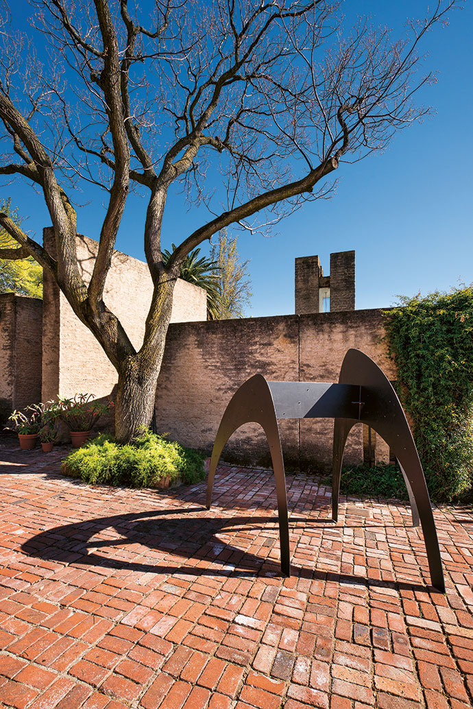 "Michael MacGarry's For Most of the Many, Much of the Time (2015) stands on the walkway at the entrance. ""We try to imagine how avant-garde Edoardo and his contemporaries were and to buy metal sculptures that are as progressive now as he was then,"" says Warren."
