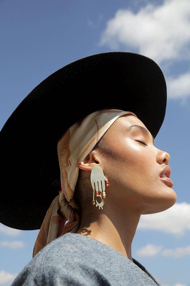 Model Lisa Philander wears Mantua Silkwear scarf, Hamsa earrings and #pichulikbynadya reversed hempdenim jacket.