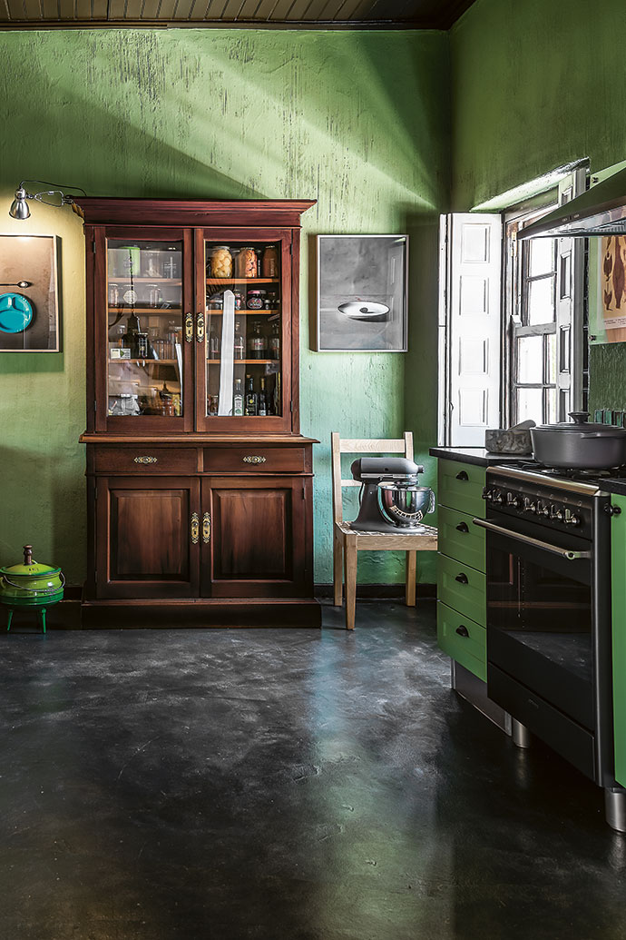 In the kitchen, Etienne assembled flat-pack cabinets, added granite countertops, brought in an antique cupboard for a larder and hung thought-provoking what-inmates-ate-as-a-last-meal photographs on the walls.