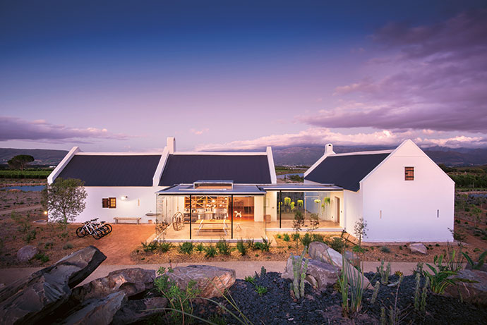 The cottages are cleverly designed to reveal and conceal: Thick white walls and deeply set windows create a natural cool, and subtly make reference to 18th-century architecture at the Cape designed to fend off a fierce sun. Glass walls offer guests a lens on the fynbos and mountains while creating light, spirit-uplifting zones. Your senses are immediately engaged.