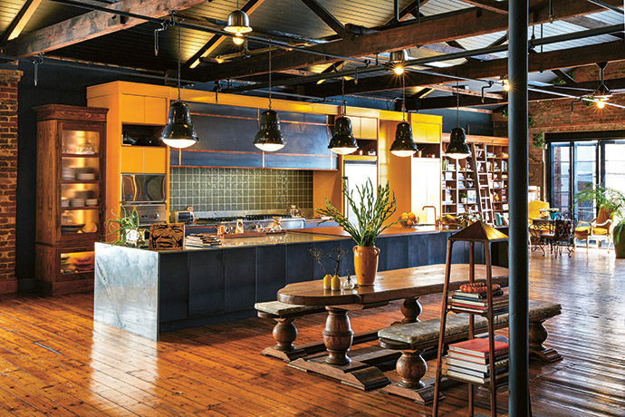 The kitchen was imagined by the homeowners and created by Carlos La Woodworks. The French oak refectory table, originally from Le Brocanteur, has been in the family for a long time, and the industrial factory lights are from Croatia.