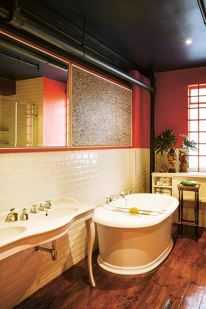The original wooden floors in the guest bathroom are complemented by subway tiles and fittings from Victorian Bathrooms.