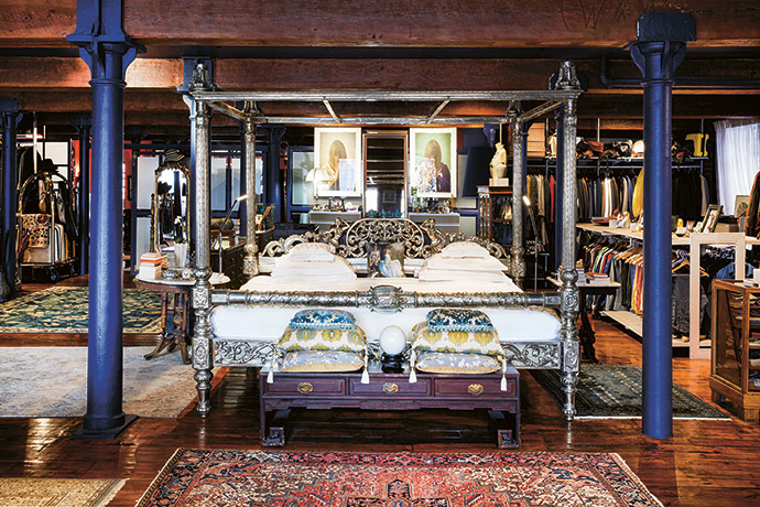 The Maharaja bed in the master bedroom, bought years ago from Private Collections, has moved house a number of times. There are no built-in closets; instead, clothes are hung on open rails and waist-high retail display stands.