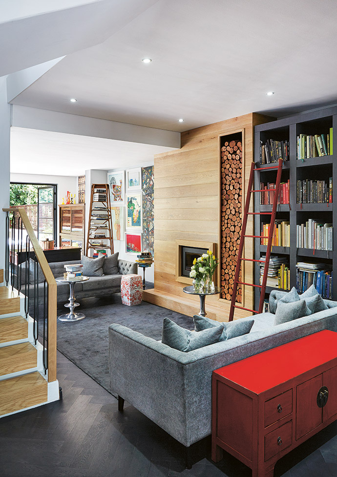 Metallic, wooden and stone elements are used throughout the house, as are the couple's favourite colours, red and black.